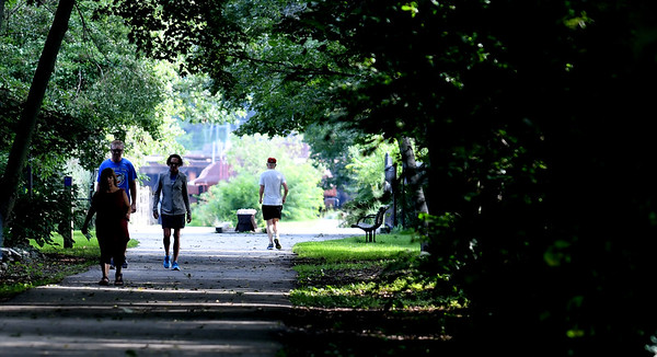 JIM VAIKNORAS/Staff photo People take advantage of the cool dry weather Sunday to walk the Rail Trail in Newburyport.