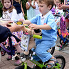 "BRYAN EATON/Staff photo. Austin Perry, 3, of Newton, N.H., whose family is from Newburyport, gets his prize for being the winner in the boys category of the Kids Day in the Park Carriage and Bicycle Parade with his ""Austin's Pet Clinic"" get up."