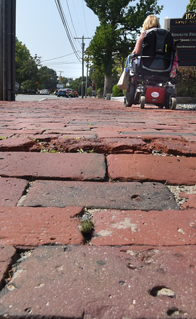 BRYAN EATON/Staff photo. Rough, older bricks, on State Street, on the south side of High Street give a bumpy ride.
