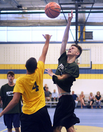CARL RUSSO/staff photo NEWBURYPORT NEWS: Pentucket's Spencer Pacy shoots over Andover's Kyle Rocker. Pentucket vs. Andover in Hoops for Hope playoffs Game 8/14/2018