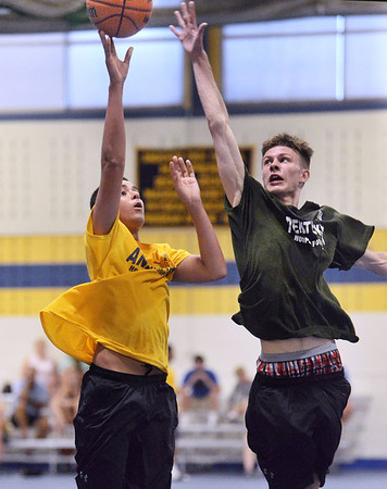 CARL RUSSO/staff photo NEWBURYPORT NEWS: Pentucket's Spencer Pacy defends against Andover's Kyle Rocker. Pentucket vs. Andover in Hoops for Hope playoffs Game 8/14/2018