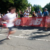 JIM VAIKNORAS/Staff photo Runners sprint past spectators at the High Street Mile Sunday morning in Newburyport.