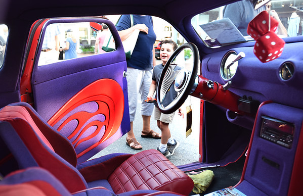 """BRYAN EATON/Staff photo. Ian Dogde, 5, of Arlington is wowed by a 1950 Ford """"Kustom."""" He was there with his grandparents Jack and Michelle Dodge of Groveland."""