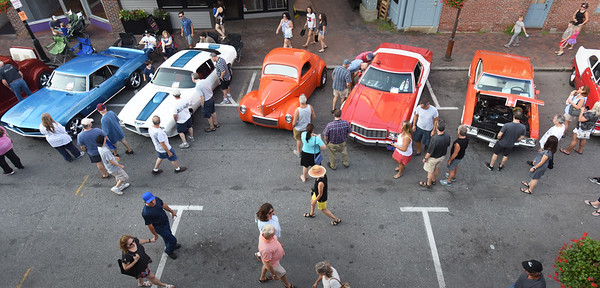 BRYAN EATON/Staff photo. Car buffs check out the models on Pleasant Street.