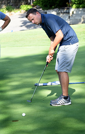 BRYAN EATON/Staff photo. Marco Hodges of Newburyport putts in the Paul Reilly Golf Tournament which raises money for the Newburyport High sports Hall of Fame. Reilly was a coach at the school and Salem High.