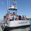 BRYAN EATON/Staff photo. People check out one of the twon U.S. Coast Guards motor lifeboats based at Station Merrimack during their open house.