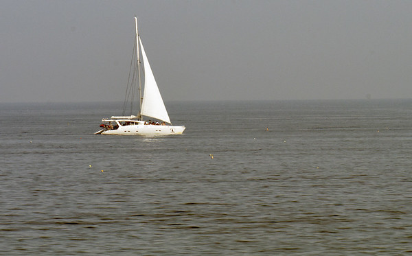 BRYAN EATON/Staff photo. The Impossible Dream under sail in a view from Salisbury Beach on their second trip of the day.