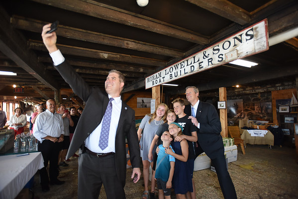 "BRYAN EATON/Staff photo. State Rep. Jim Kelcourse takes a ""selfie"" with students and Governor Charlie Baker who was on a tour of Lowell's Boat Shop in Amesbury on Friday afternoon."
