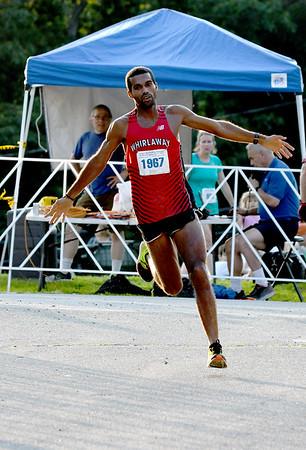 JIM VAIKNORAS/Staff photo  Ruben Sanca wins the 10 mile  in the Newburyport Lions Club Yankee Homecoming Road Race.
