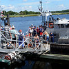 BRYAN EATON/Staff photo. Many people turned our for the U.S. Coast Guard, Station Merrimack's open house, touring the boats after going inside the headquarters.