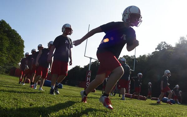 BRYAN EATON/Staff photo. Amesbury High football players sprint around the field Monday afternoon.