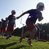 BRYAN EATON/Staff photo. Amesbury High football players sprint around the field Monday afternoon.