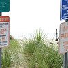 BRYAN EATON/Staff photo. Signs at public access points to Seabrook Beach, this one at the end of Hooksett Steet advises beach-goers there are not lifeguards. Several swimmers were pulled from a riptide on Sunday with one swimmer who died from his injuries.