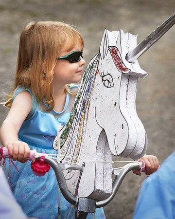 "BRYAN EATON/Staff photo. Laina McBee, 3, of Uxbridge dressed as Elsa from ""Frozen"" on a unicorn bicycle poses for a photo. Her mother, Cayla, who's is from Newburyport participated as a youngster at the Kids Day in the Park Carriage and Bicycle Parade."