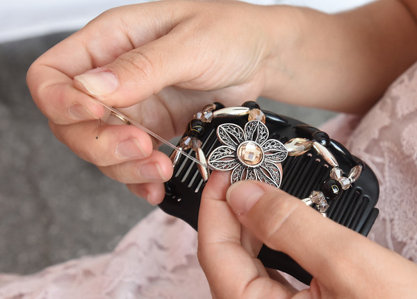 BRYAN EATON/Staff photo. Kateryna Glibishchuk of Boston makes handmade hair clips as Fancy Combs at the Market Square Craft Show.