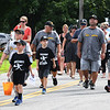 JIM VAIKNORAS/Staff photo THe Seacoast Hitmen give out candy as they march Walton Road in the Seabrook's 250th Day parade Saturday.