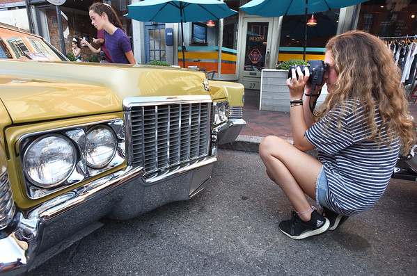 BRYAN EATON/Staff photo. Photography hobbyist Ava Queiros, 12, of Hampstead, N.H. captures a 1970 Cadillac Coupe de Ville. She is a photography student at Sea Shore Photography at the Tannery in Newburyport.