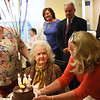 BRYAN EATON/Staff photo. Jill Ramsdell presents Clara Sillars with a smaller version of her other birthday cake on Friday afternoon. The Atria Merrimack Place resident turned 108 years-old.