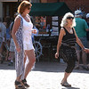 BRYAN EATON/Staff photo. Debra Bartnicki, left, of Newburyport and Ruth Greenstein of Amesbury dance to the music of R & R in Market Square.