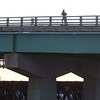 BRYAN EATON/Staff photo. A runner heads up the Gillis Bridge over the Merrimack River this past weekend. The bascule bridge, which is supposed to open every hour and half hour during summer months, will revert to being opened on demand after Labor Day.