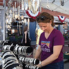 BRYAN EATON/Staff photo. Marianne Gasbarro of Newburyport checks out the goods at The Silver Spoon booth at the Market Square Craft Show.