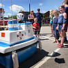 "BRYAN EATON/Staff photo. Youngsters get a kick out of ""Coastie"" a talking boat the dispenses humor with water saftey tips at USCG Station Merrimack's open house."
