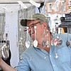 JIM VAIKNORAS/Staff photo Steven Manning of the Silver Spoon sells his hand made silver item on State Street Tuesday.