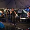 JIM VAIKNORAS/Staff photo  Beatles cover band Beatlejuice perform at Market Landing Park in Newburyport Thursday night.