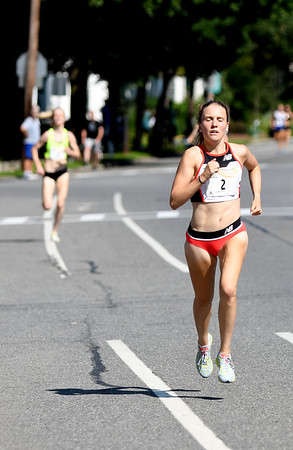 JIM VAIKNORAS/Staff photo Katrina Coogan wins the High Street Mile Sunday morning in Newburyport.