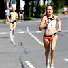 JIM VAIKNORAS/Staff photo Katrina Coogan wins the High Street Mile Sunday morning in Newburyport.