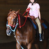 BRYAN EATON/Staff photo. Madelyn Madore, 8, learns to stop her horse by pulling back on the rein.