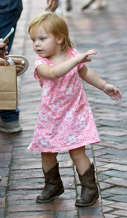 JIM VAIKNORAS/Staff photo Jacqueline Janeczak, 2, of Andover dances in her cowboy book in Market Square during Yankee Homecoming Tuesday.
