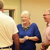 BRYAN EATON/Staff photo. Longtime Amesbury community volunteer Rosey Werner, with Amesbury police chief William Scholtz, greet well-wishers at Amesbury Town Hall on Saturday as she her husband, ,Jack, were feted as they are moving to Florida. She quipped in a story about their departure that maybe five people would show up, of course there were scores who came to say goodbye.