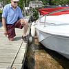 BRYAN EATON/Staff photo. George Lay has been watching the discharge of sewage into the Merrimack River in Merrimac, where he docks his boat, and says it's getting worse.