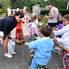 BRYAN EATON/Staff photo. Yankee Homecoming General Chairman Maureen Ryan greets youngsters before the Kids Day in the Park Carriage and Bicycle Parade.