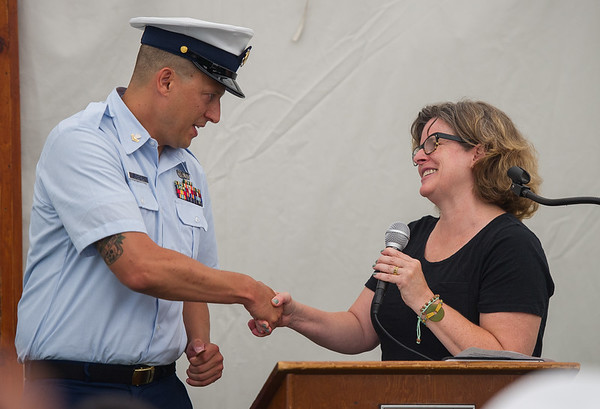 AMANDA SABGA/Staff photo<br /> <br /> Petty Officer Robert Munroe is presented with the 2018 Rear Admiral Richard I. Rybacki Award by Lucinda Cathcart, daughter of Rear Admiral Ryabacki, at the Custom House Maritime Museum in Newburyport. <br /> <br /> 8/4/18