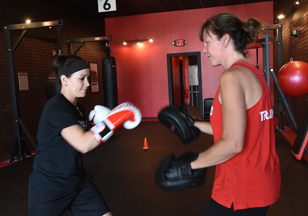 BRYAN EATON/Staff photo. Heather Sorrentino of Seabrook, left, works out with Kendra Hackett.