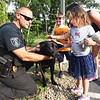 BRYAN EATON/Staff photo. Salisbury canine officer Sgt. Rich Dellaria indroduces Herc to Brooklyn Forget, 4, with her brother Ryan, 7, and mother Michelle on Tuesday night. They were at Salisbury's Night Out, a national campaign to promote relationships between emergency agencies with their communities.