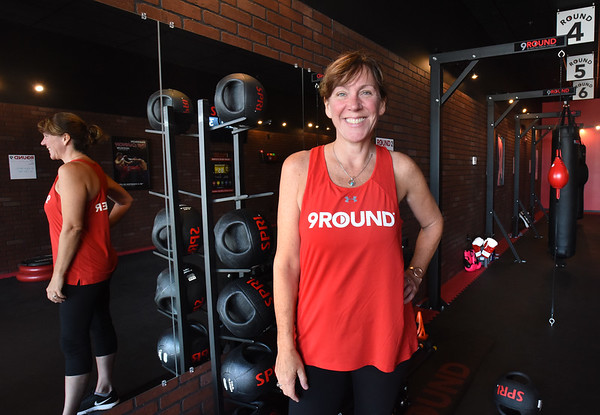 BRYAN EATON/Staff photo. Kendra Hackett recently opened up a new boxing gym in Seabrook called 9Round Fitness. It's a type of boxing gym that has been steadily growing over the past decade, and she quit her corporate job about a month ago to follow her passion.
