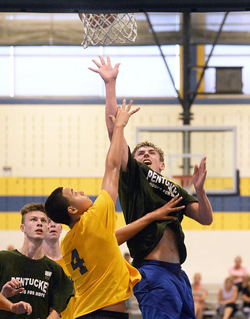 CARL RUSSO/staff photo NEWBURYPORT NEWS: Pentucket's Jake Etter drives to the hoop against Andover's Kyle Rocker. Pentucket vs. Andover in Hoops for Hope playoffs Game 8/14/2018