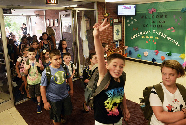 BRYAN EATON/Staff photo. Students stream in to Amesbury Elementary School, some with lots of enthusiasm, Wednesday morning as classes begin.