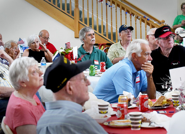 BRYAN EATON/Staff photo. Military veterans listen as U.S. Army staff sergeant (Ret.) Zeke Crozier speaks about his Chinook helicopter crashing at the Yankee Homecoming Veteran Luncheon.