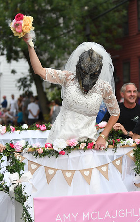 JIM VAIKNORAS/Staff photo Amy McLaughlin rode a bed as Bridezilla at the Lions Club Bed Race on Federal Street in Newburyport Thursday night.
