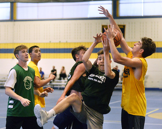 CARL RUSSO/staff photo NEWBURYPORT NEWS: Pentucket's Ryan Gallagher fights for the ball against  Andover player.Pentucket vs. Andover in Hoops for Hope playoffs Game 8/14/2018