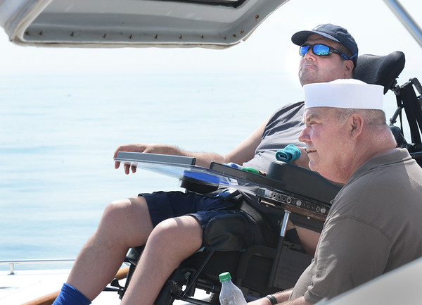 BRYAN EATON/Staff photo. Donny Duggan, top, and Peter Geary take in the views of the calm Atlantic Ocean.