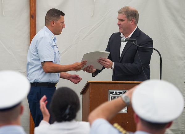 AMANDA SABGA/Staff photo<br /> <br /> Petty Officer Robert Munroe, winner of the 2018 Rear Admiral Richard I. Rybacki Award, receives a commendation from State Rep. James Kelcourse at the Custom House Maritime Museum in Newburyport. <br /> <br /> 8/4/18