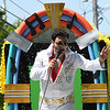 JIM VAIKNORAS/Staff photo Josef Nocera performs as the King of Rock and Roll in the Yankee Homecoming Parade Sunday.