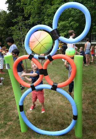 BRYAN EATON/Staff photo. Colin Makin, 3, of Amesbury gets the ball through one of the hoops in the game sponsored by Latitude's Sports Club in Salisbury at the Kids Day in the Park.