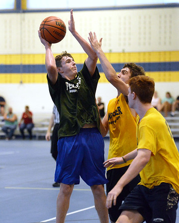 CARL RUSSO/staff photo NEWBURYPORT NEWS: Pentucket's Jake Etter drives to the hoop against Andover defenders.  Pentucket vs. Andover in Hoops for Hope playoffs Game 8/14/2018