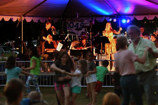 JIM VAIKNORAS/Staff photo Marina Evans fronts the Compaq Jazz Band as dancer enjoy the show Saturday night in Market Landing Park.